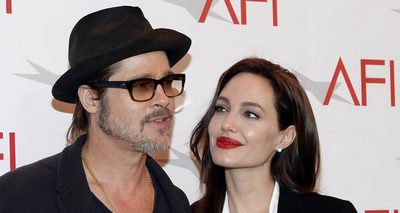Actor Brad Pitt and actress/director Angelina Jolie pose at the AFI Awards 2014 honoring excellence in film and television in Beverly Hills, California on January 9, 2015. REUTERS/Kevork Djansezian (UNITED STATES - Tags: ENTERTAINMENT) *** Local Caption *** ANGELINA JOLIE AND BRAD PITT